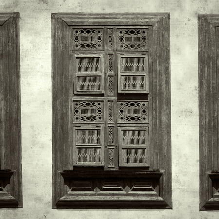 textured stylish old paper background, square, with ornate wooden shutters Фото со стока