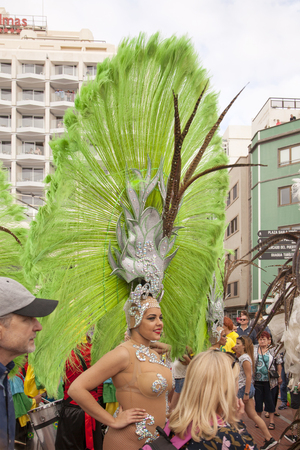 LAS PALMAS DE GRAN CANARIA, SPAIN - March 02: Samba groups in colorful costumes take part in Carnival parade along Las Canteras beach, on March 02, in Las Palmas de Gran Canaria, Spain