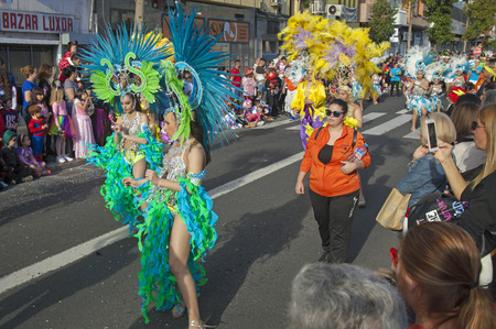 LAS PALMAS DE GRAN CANARIA, SPAIN - March 05: Participants and viewers in bright costumes enjoying Cabalgata Infantil, Children Carnival Parade, on March 05, in Las Palmas de Gran Canaria, Spain