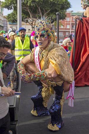 LAS PALMAS DE GRAN CANARIA, SPAIN - March 09: Participants and viewers in bright costumes enjoying Main Carnival Parade, on March 09, in Las Palmas de Gran Canaria, Spain