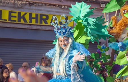 LAS PALMAS DE GRAN CANARIA, SPAIN - March 05: Viewers and participants and in bright costumes enjoying Cabalgata Infantil, Children Carnival Parade, on March 05, in Las Palmas de Gran Canaria, Spain 스톡 콘텐츠 - 120299881