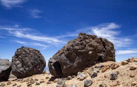 Tenerife, view from hiking path to the summit towards dark lava bombs called Huevos del Teide, Eggs of Teide