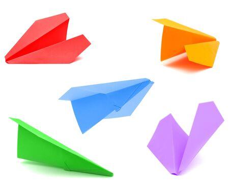 Avión de papel hecho de papel de color aislado en whte Foto de archivo