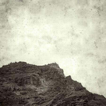 textured stylish old paper background, square, with Gran Canaria landscape, Agaete valley