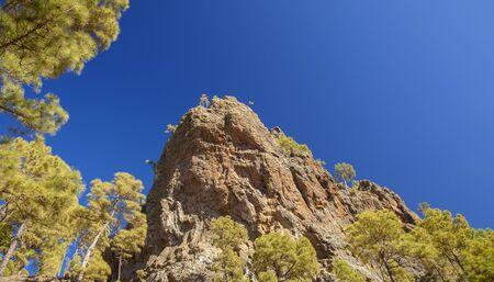 Gran Canaria, July, view upwards steep cliff Morro Guanil, blue sky