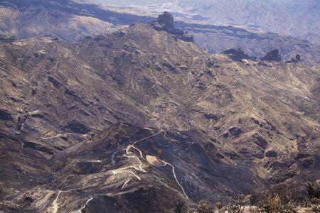 Gran Canaria after wild fire of August 2019, walking route La Cruz de Tejeda - Artenara, Caldera de Tejeda with its iconic rock formation Roque Nublo Reklamní fotografie - 129966036