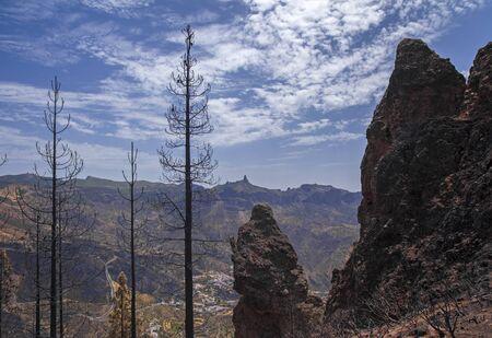 Gran Canaria after wild fire of August 2019, walking route La Cruz de Tejeda - Artenara, view across Caldera de Tejeda towards iconic Roque Nublo rock formation