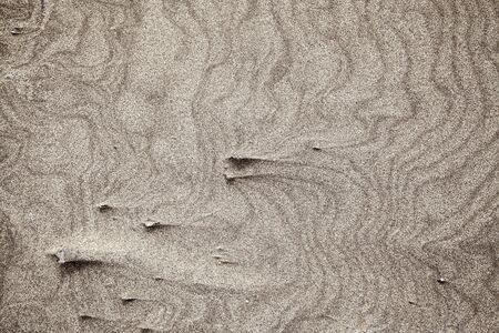 sand and wind pattern on  surface made solid with dried spray, Lanzarote, Canary Islands, 스톡 콘텐츠
