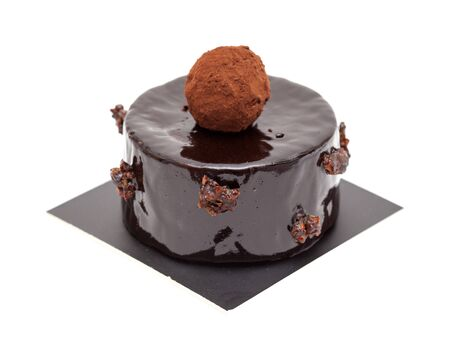 small individual mousse cake with mirror glaze isolated on white