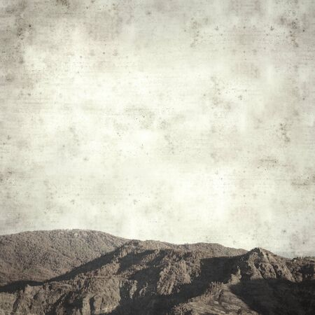 textured stylish old paper background, square, with landscape of Gran Canaria after forest fire