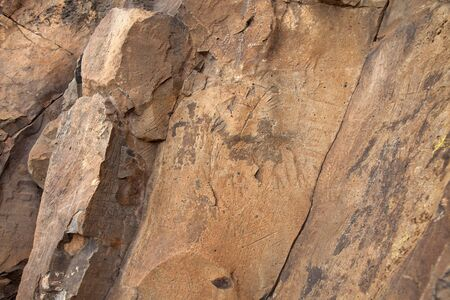 Gran Canaria, aboriginal rock art examples found on rock face on the top of  Montana de Aguimes mountain, two human figures visible in the center, larger, more famous The Man of Guayadeque to the right Stock Photo