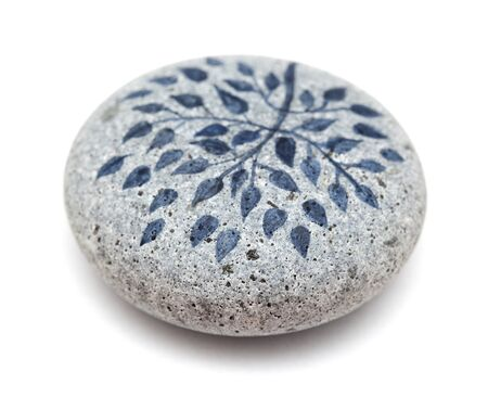 painted pebble paperweight isolate on white background