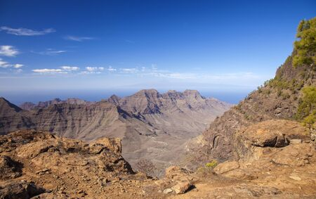 Gran Canaria, November 2019, view from the western borders of Nature reserve Inagua towards Guigui mountains and Teide on Tenerife in far distance Stock Photo
