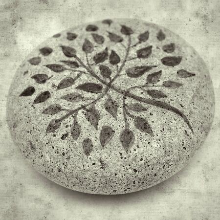 textured stylish old paper background, square, with painted pebble paperweight Banque d'images
