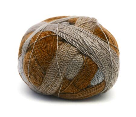 new wool yarn ball ingrey and mustard isolated on white Stock Photo