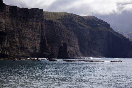 Gran Canaria, vertical walls of Puerto de las Nieves bay, rocky outcrop remains where Dedo de Dios, God Finger, used to be till 2005