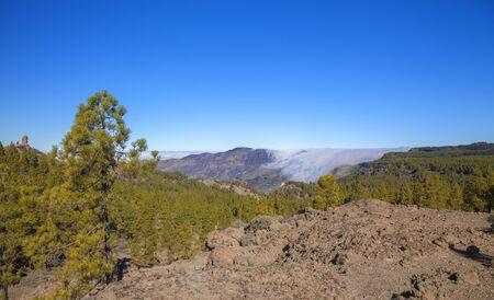 Gran Canaria, January, clouds falling over the edge into Caldera de Tejeda, view from Degollada de Los Hornos pass
