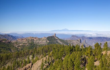 Gran Canaria, January, view from surroundings of Pico de Las Nieves, the highest point of the island, towards Teide on Tenerife, Roque Nublo and Roque Bentayga formatios both visible