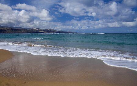 sky over Las Canteras beach in Las Palmas de Gran Canaria, waves breaking over La Barra sandbank