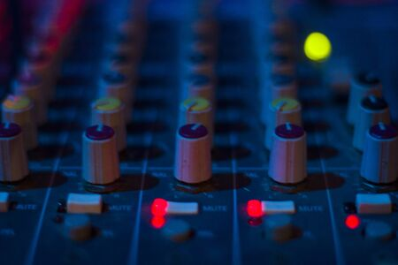 DJ controller and color Light Music Instrument Backgrounds. Audio mixer and music mixing. 写真素材