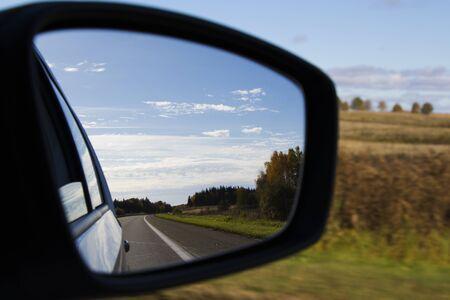 Road in car mirror