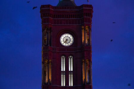 Famous landmark and architecture clock tower, red tower in Berlin, Germany