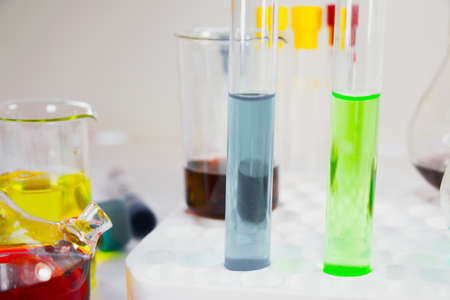 Laboratory chemical liquid elements and research diagnoses, instruments and objects in the sterile table, glassware and pipette.