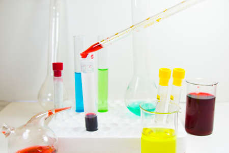 Chemical laboratory instruments, glassware and pipette. Tests and research diagnoses in lab.