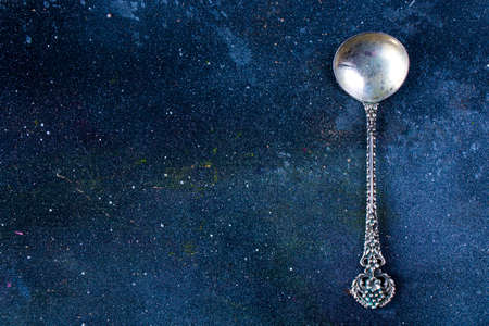 Silverware, silver vintage spoon background, spoon set on the dark background