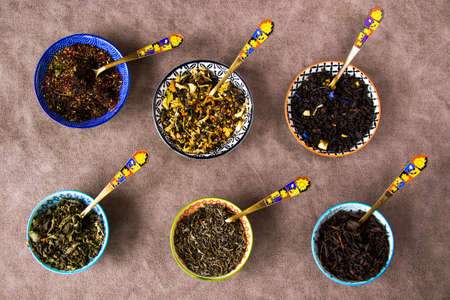 Herbal and natural dry tea set, variation and collection of tea and vintage spoons