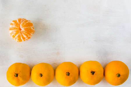 large group of the clementines on the white background, orange color background