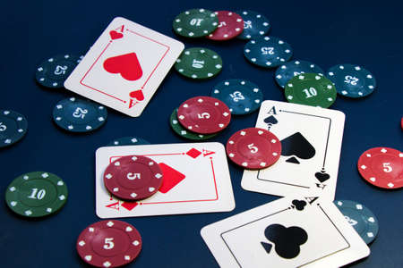Four aces and chips, card game, cards on the table. Poker and blackjack, play cards.