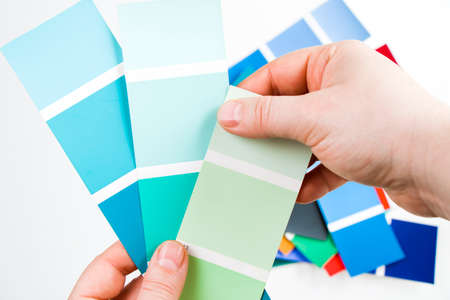 High angle view of color cards on the white background, colorful variation and gradient of colors. Stock Photo