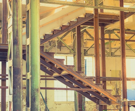 abandoned: Abandoned old industrial interior stairs. Stock Photo