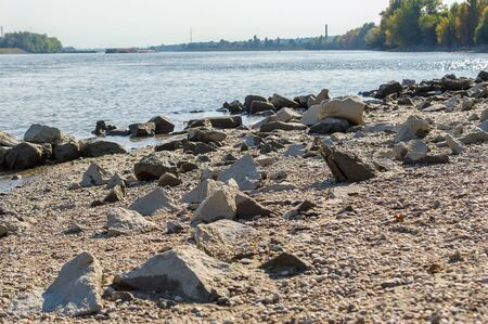 River shore with rocks autumn afternoon.