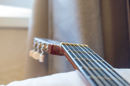 Detail of classic acoustic guitar with shallow depth of field.