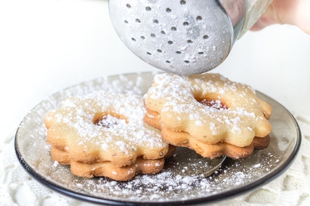 linz: Homemade apricot jam Linzer with icing sugar on the white table close up. Stock Photo
