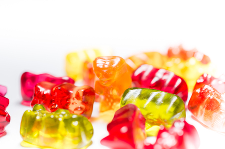 Heap of Gummi Bears isolated on white background.