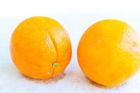 reticulata: Two orange on snow background. Ripe fruits