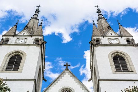 most popular: Old church towers with clock, abstract view - Romania Transylvania Stock Photo