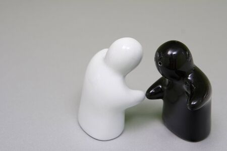 salt n pepper hand shake Stock Photo