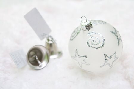 Close up christmas decoration with bells on white background.