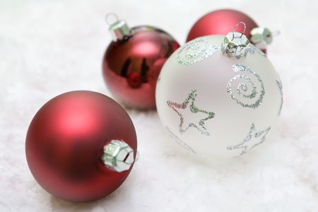 Mixed christmas balls in red and white colour.