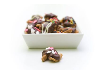 Some sweet things like chokolate, nuts and candys. Shallow depth of field. Stock Photo