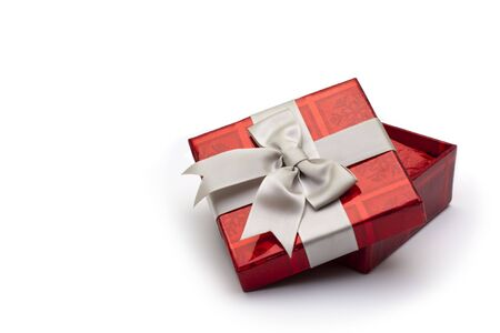 A red gift box with white ribbon, for any occasion.