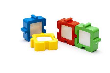 Puzzel photo frames in a row, in various colors, and isolated on white background.