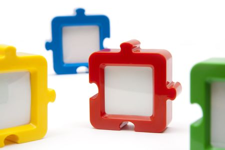 Puzzel photo frames, in various colors, and isolated on white background.