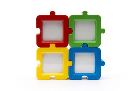 Puzzel photo frames in a square arragement, in various colors, and isolated on white background.