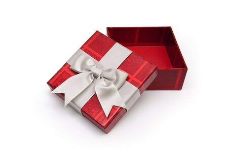 An opened red gift box from above with white ribbon, for any occasion. Stock Photo