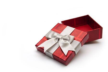 An opened red gift box with white ribbon, for any occasion. Stock Photo